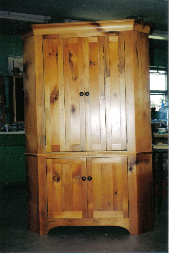 Large corner cupboard made from solid cherry wood.